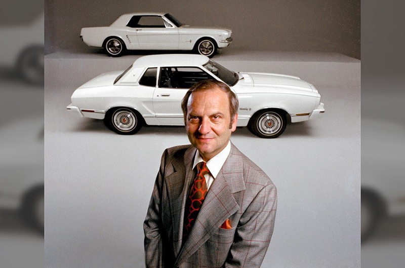 Lee Iacocca with the Mustang II (front) and the original Ford Mustang (rear.)