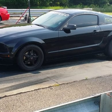 Video: 2006 Ford Mustang GT vs 2003 Mach 1 Mustang Shoot Out
