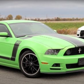 Video: 2013 Ford Mustang Boss 302 vs. 2013 Mitsubishi Lancer Evolution MR