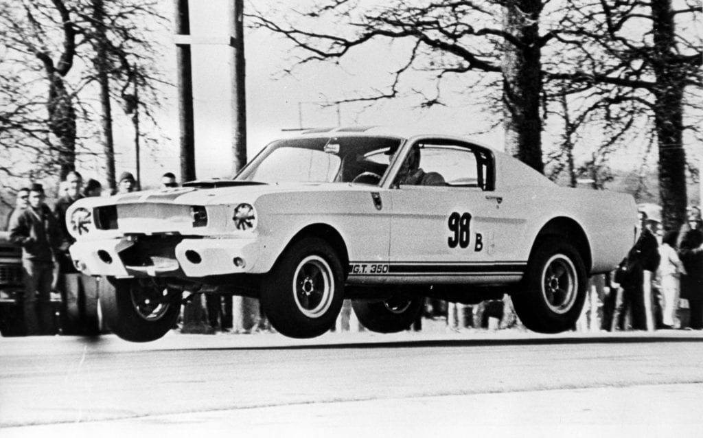 Ken Miles and the 1965 Ford Mustang GT350R go airborne at the Green Valley Raceway in Smithfield, Texas on February 14, 1965.